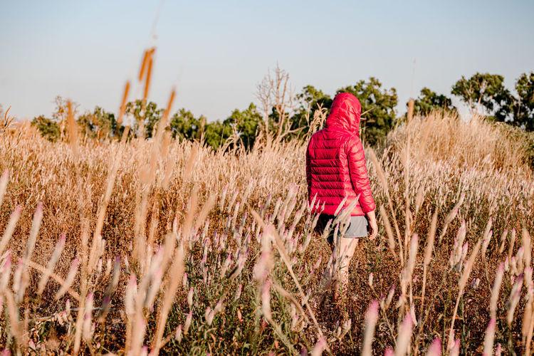 Rear view of woman walking on land