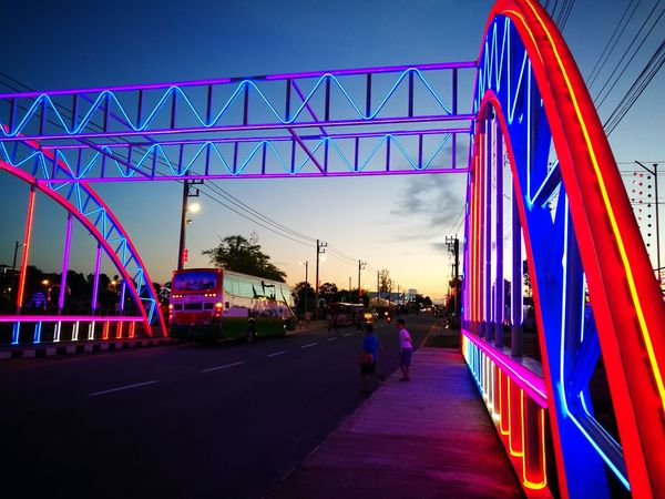 Illuminated People Night Architecture Bridge - Man Made Structure Arts Culture And Entertainment Adults Only Sunset Travel Destinations Outdoors Multi Colored Adult Lifestyles Sky Real People Only Men