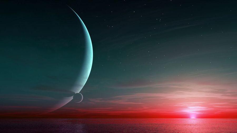 Half moon shinning above sea at night