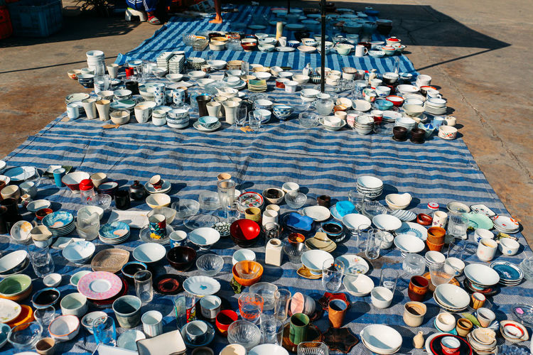 High angle view of crockery on street for sale