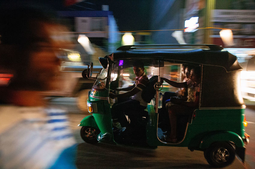 The streets were bustling and writhing with energy in Galle as Sri Lankans celebrated Vesak, the day of Buddah. Shooting from a Tuk Tuk in low light is extremely difficult in ever changing circumstances with light shifting every time traffic moves. The Street Photographer - 2018 EyeEm Awards The Traveler - 2018 EyeEm Awards TukTuk Blurred Motion Driving Focus On Foreground Illuminated Land Vehicle Long Exposure Mode Of Transportation Motion Motor Vehicle Night on the move Rickshaw Road Street Street Photography Transportation Travel Vesak