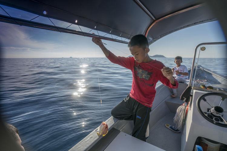 Tourist on boat sailing in sea