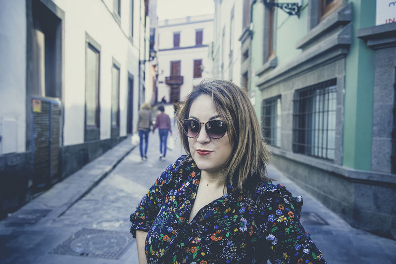 One Person Architecture Building Exterior Built Structure Fashion Portrait Sunglasses Front View City Real People Focus On Foreground Lifestyles Beautiful Woman Young Adult Beauty Women Glasses Leisure Activity Outdoors Hairstyle