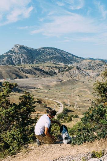 People on landscape against mountain range