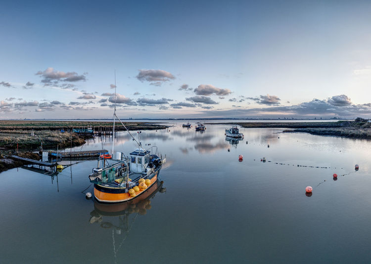Sunset over boats in stone creek harbour, sunk island, east riding of yorkshire, uk