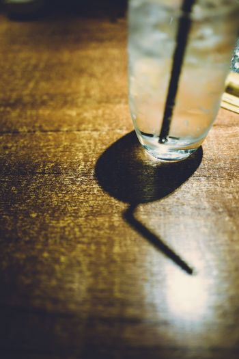 Life October 2018 Think About... Shadow Discoverhongkong Nightshooters Reframinghk Table Shadow Sunlight Indoors  No People Wood - Material Close-up Still Life Selective Focus Day Flooring Single Object Drink Nature Refreshment Food And Drink Glass - Material Glass Drinking Glass Focus On Shadow