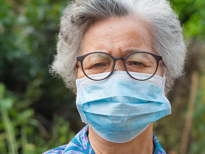 Close-up portrait of woman wearing mask