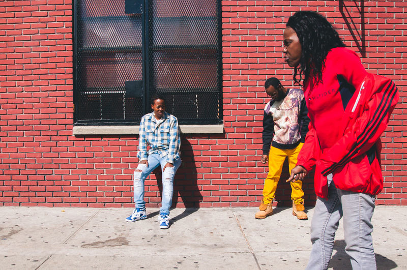 Bricks Casual Clothing Day Front View Harlem  Harlem, NYC Jacket Lifestyles New York Outdoors Possing Red Streetphotography The Street Photographer - 2016 EyeEm Awards The Street Photographer -2016 EyeEm Awards The Street Photographer – 2016 EyeEm Awards Walking Around Yellow