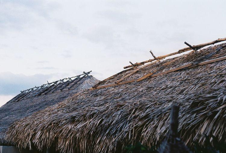 Tilt image of roof against sky during winter