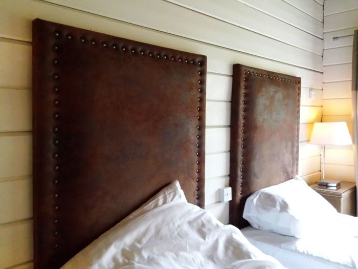 Bed Bedroom Indoors  Built Structure No People Day Architecture Beds Unmade Bed Close-up Composition Pillow Arrangement Tranquility Cabin Interior Room Indoors  Bed Head Board Leather Decor Holiday Resort