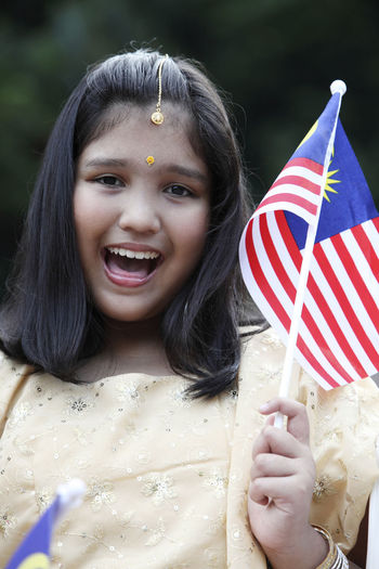 malaysian of chinese malay and indian kids together with traditional clothing Happiness Indian Innocence Kids National Day Patriotism Traditional Clothing Childhood Chinese Different Cultures Group Of People Independence Day Lifestyles Malay Malaysia Malaysia Flag Merdeka Mixed Race Multiracial  Outdoors Positive Emotion Real People Religion Smiling Togetherness