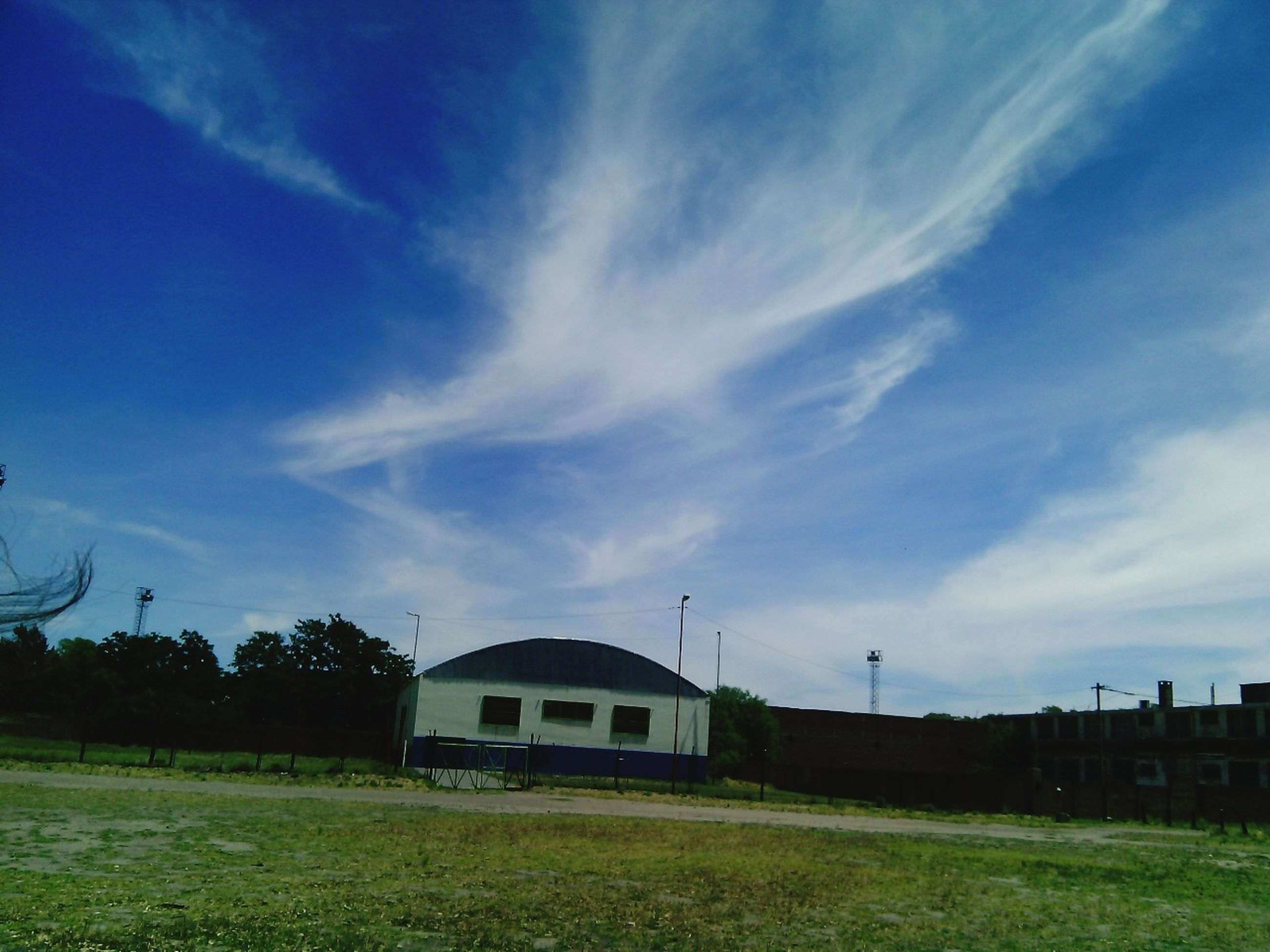 sky, grass, cloud - sky, field, no people, rural scene, built structure, nature, agriculture, landscape, outdoors, architecture, day