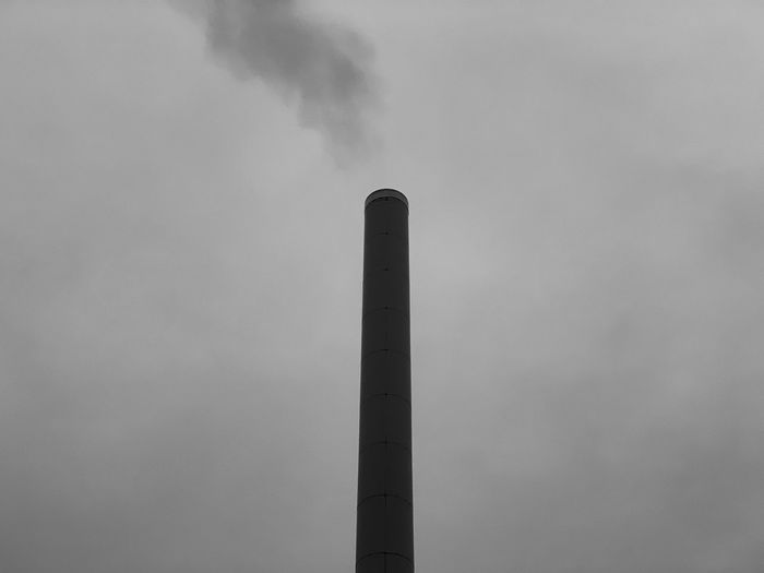 Sky Building Exterior Smoke Stack Pollution Low Angle View Factory Environmental Issues Built Structure Industry No People Architecture Smoke - Physical Structure Tall - High Nature Day Outdoors Emitting Environment Air Pollution