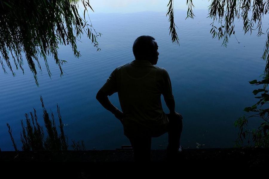 Streetphotography Yoonjeongvin Hanoi Vietnam Silhouette Lake One Person Reflection Tree Standing Water
