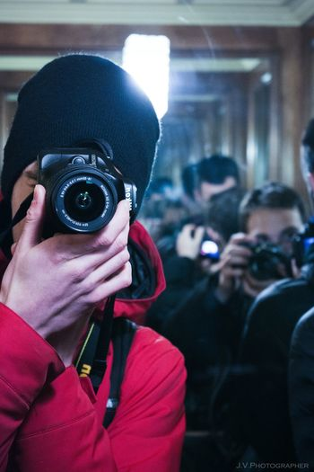 Close-up of person wearing camera