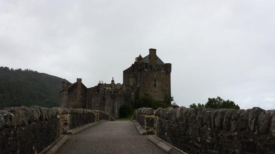 Footpath Leading Towards Eilean Donan Castle Against Clear Sky