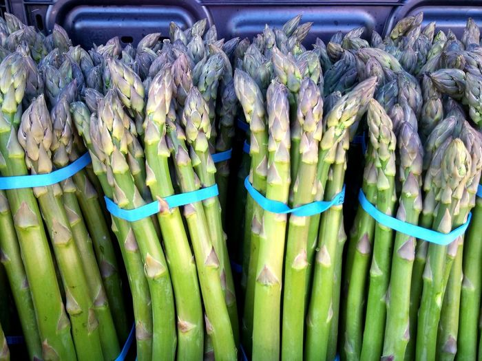Close-up of asparagus bunches at market stall