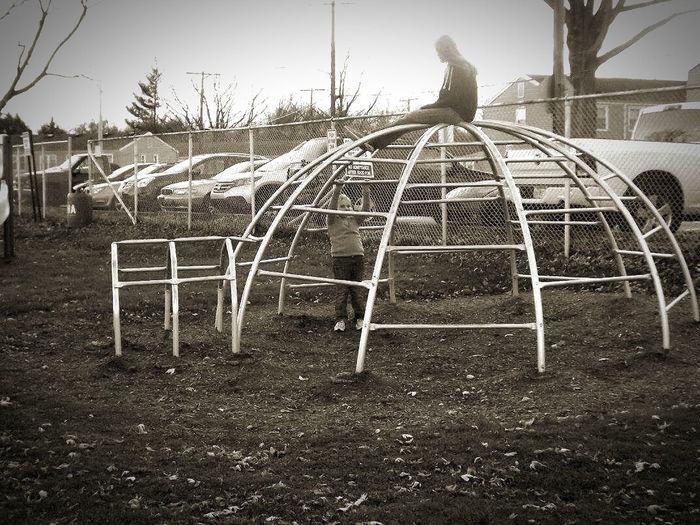 Playground Jungle Gym Park Kids Being Kids Kids Playing Full Length Clear Sky Bare Tree Outdoors Solitude Day City Life Sunlight Urban Skyline Old Photo Effects Urban Escape Cityscape