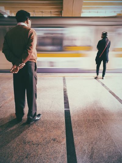 Mannerisms. EyeEm Ready   Blurred Motion Full Length Motion Speed Train - Vehicle Adult Transportation People Adults Only Standing Real People City Subway Train Working