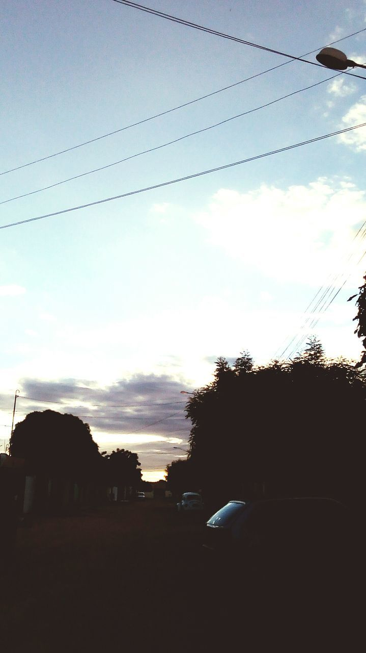 cable, sky, tree, car, cloud - sky, transportation, power line, land vehicle, no people, silhouette, electricity pylon, outdoors, road, day, electricity, sunset, nature, telephone line