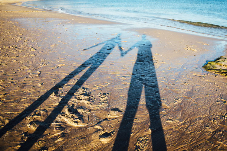 Couple on Algarve beach Algarve Couple Love Portugal Sand Beach Beach Day Focus On Shadow High Angle View Land Leisure Activity Lifestyles Men Nature Outdoors People Real People Sand Sea Shadow Sunlight Togetherness Two People Water