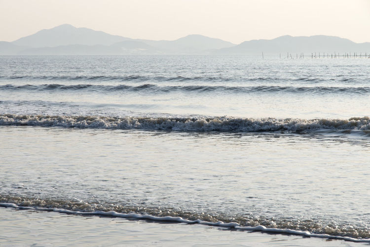 beach scenery at Jeungdo Island in Sinan, Jeonnam, South Korea Afternoon Wave Winter Beach Winter Sea Afternoon Beach Beach Beauty In Nature Day In The Afternoon Mountain Nature No People Outdoors Salt - Mineral Scenics Sea Seaside Sky Tranquil Scene Tranquility Travel Destinations Water Wave