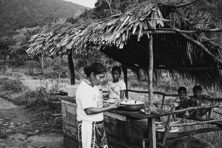 Some locals in the plains of Ilocos Norte, Philippines. Thatched Roof Outdoors Real People Tree Sitting Day Nature Men Lifestyles Togetherness Young Adult Boys Mountain Young Women Adult People EyeEmNewHere Connected By Travel Black And White Friday