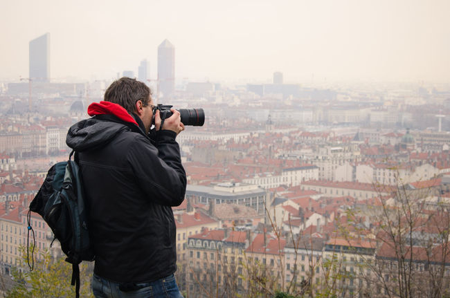the photographer Adult Adults Only Architecture Camera - Photographic Equipment City Cityscape Day Men Outdoors People Photograph Photographer Photographing Photography Photography Themes Portable Information Device Selfie Shooting Sky Technology Traveler Traveling Urban Skyline Winter Wireless Technology