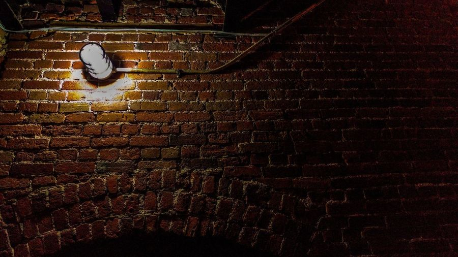 Brick Wall Wall Brick Architecture Wall - Building Feature Lighting Equipment Illuminated Built Structure Low Angle View No People Night Indoors  Pattern Light Textured  Electric Lamp Electric Light Spotlight Light Fixture