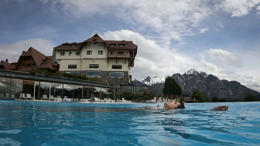 Hotel #LlaoLlao #Argentina #Bariloche Water Architecture Building Exterior Built Structure Sky Cloud - Sky Waterfront Nature Building Day Swimming Pool Real People Swimming Pool Outdoors Leisure Activity House Sea Reflection Inflatable  Floating On Water Bariloche, Argentina Llao Llao Patagonia Argentina