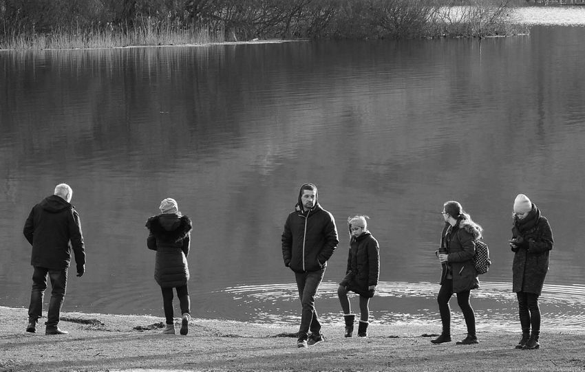 Sunshine Steeet Photography Monochrome Photography Streetlife UK Black And White Adults Wintertime Lakeside Reflections Real People Walking Outside Dayout Reeds Trees Water People Outdoors Sunlight Day Beach