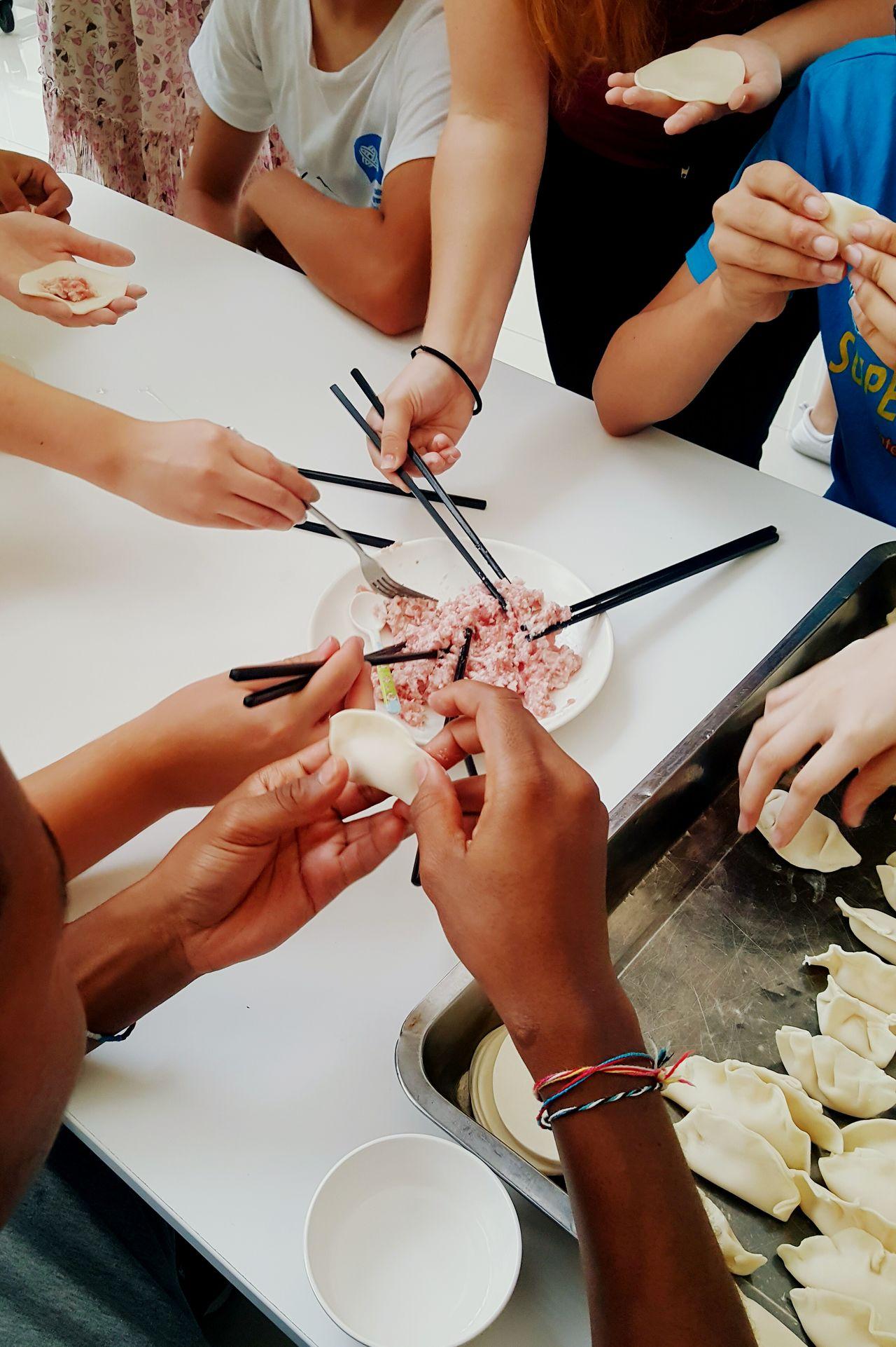 Making dumplings together