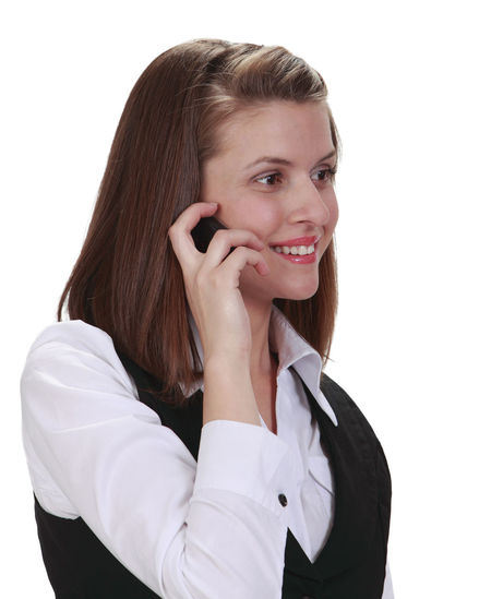 Portrait of a young woman on a mobile phone against a white background. White Background Smiling One Person Young Adult Telephone Communication Using Phone Talking Studio Shot Portrait Wireless Technology Mobile Phone Technology Beautiful Woman Happiness Women Young Woman Woman Using Phone Mobile Phone Businesswoman