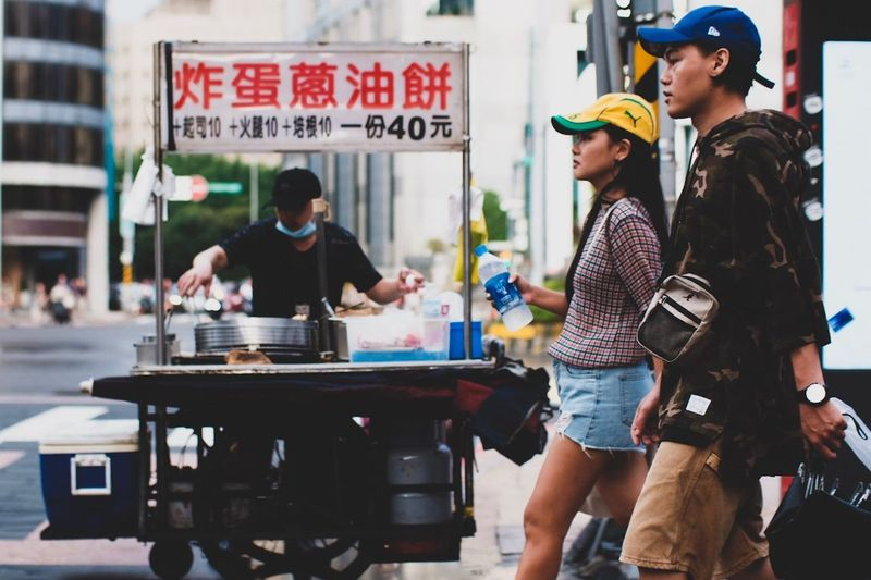People standing on display in city