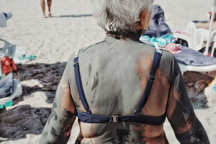 Rear View Sand Mud Beach People Swimsuit One Woman Only Old Woman Covered In Mud One Person Beach Life Summer Sun Lounger Muddy Human Neck The Week On EyeEm Editor's Picks