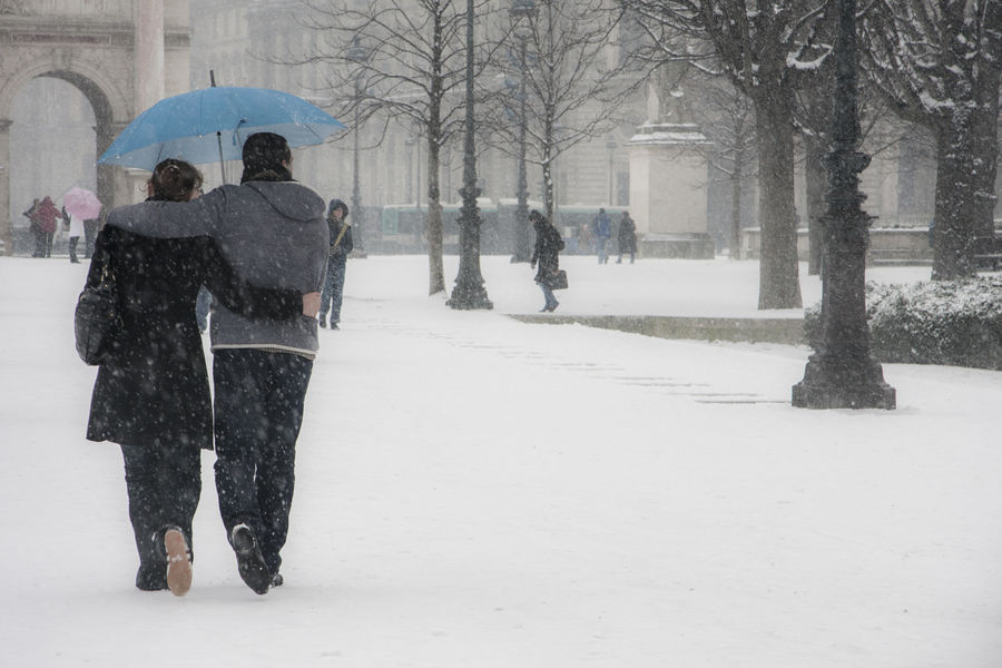 Snow in Paris. Tuileries garden. Romantic couple walking under a blue umbrella. Capital Cities  Cityscape Cold Temperature Couple Famous Place Global Warming International Landmark Love Real People Rear View Romantic Snow Snow In Paris Snow In The City Snowing Taking Care Tenderness Togetherness Umbrella Valentine's Day  Walking Weather Paris The Street Photographer - 2016 EyeEm Awards Feel The Journey