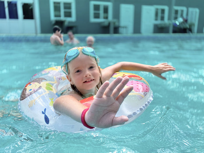 Portrait of a girl swimming in pool