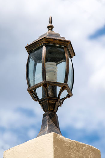 Low angle view of lamp against sky