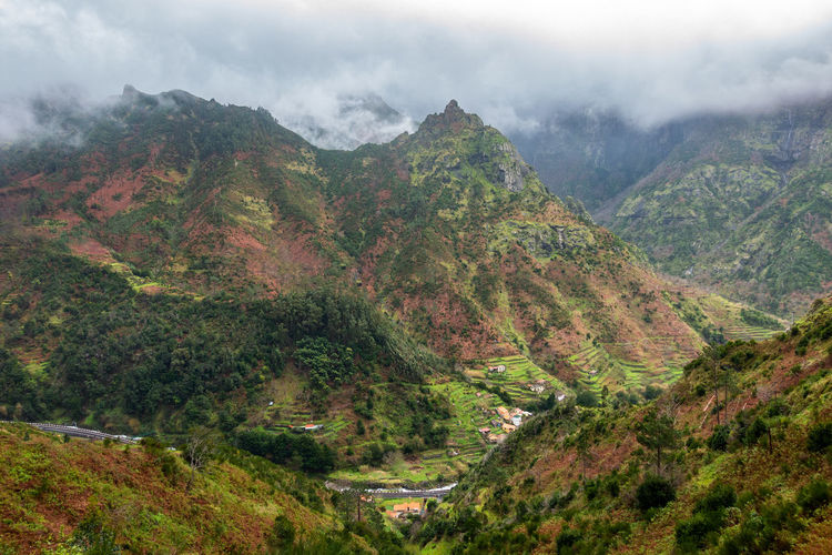 Beautiful landscape mountains with clouds, in Madeira Madeira Portugal Island Ilha Travel Landscape Nature Mountain Outdoors Panorama Panoramic Aerial View Fog Cloudy Foggy Road Funchal Portuguese Europe Trees Scenics Hiking Adventure Natural Tourism