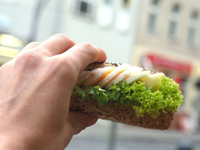 Cropped Image Of Hand Holding Sandwich
