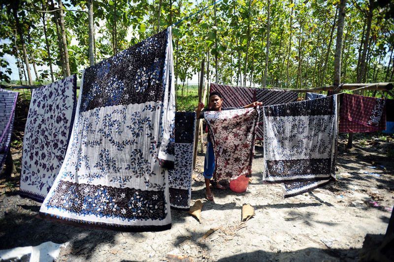 batik lasem Obsolete Belief Textile Abandoned Religion Old Hanging Communication Metal Boundary Fence Container Day Outdoors Sunlight Tree Nature Plant No People Land