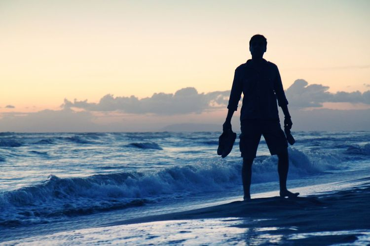 Ankle Deep In Water Beach Beauty In Nature Horizon Over Water Men Nature One Person Real People Scenics Sea Silhouette Standing Summer Summertime Sunset Sunset Silhouettes Water Wave Young Adult Sommergefühle Done That. Summer Exploratorium
