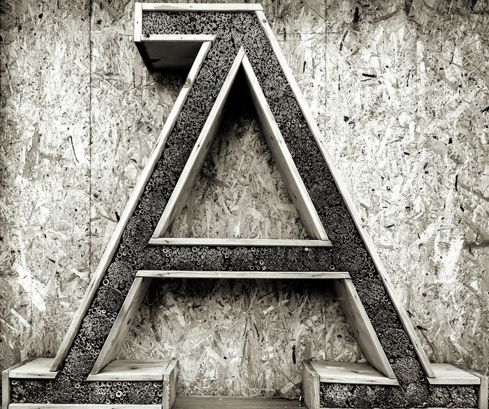 A... Bee Hotel Start Beginnings Shape Design No People Pattern Built Structure Triangle Shape Geometric Shape Sign Communication Close-up Detail Small Business Heroes
