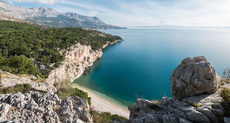 Panorama of scenic beach and sea landscape on Makarska riviera Water Sea Scenics - Nature Beauty In Nature Tranquil Scene Tranquility Nature Day No People Outdoors Beach Hidden Pine Tree Forest Landscape Panorama Travel Vacations Holiday Summer Makarska Makarska Riviera Dalmatia Croatia Europe Adriatic Sea Mediterranean  Scenics Sunny View Horizon Over Water Coastline Coast Shore Nature Natural Calm Tranquility Serene Nugal