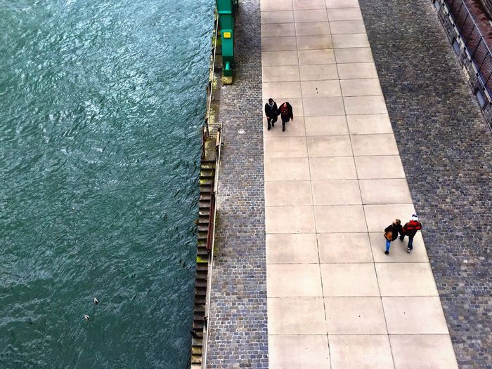 High angle view of people walking on promenade by rhine river