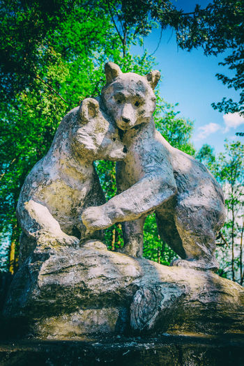 """""""Two Bear"""" sculpture. Abandoned and forgotten sculptures in the village. Abandoned Object Mammal Monument Nature No People Outdoors Park Sculpture Tree"""