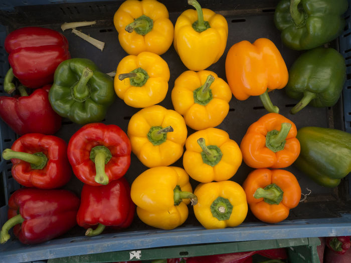 High angle view of bell peppers for sale at market stall