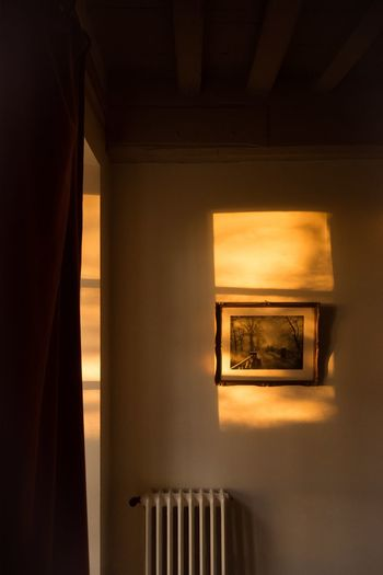 Chasing light Light Light And Shadow Indoors  Architecture Illuminated No People Built Structure Wall - Building Feature Window Absence Home Interior Orange Color Wall