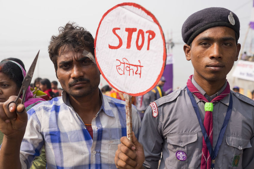A boy scout on crowd control is joined by a local hairdresser bearing his scissors for an unusual portrait. Sonepur Mela, Bihar Adults Only Beret Bihar Boy Scouts Day Hairdresser Hajipur India Indians  Looking At Camera Outdoors Portrait Scissors Scout Scouts Smart Sonepur Sonepurmela Stop Stop Sign Toggle Travel Travel Photography Travelphotography Young Adult