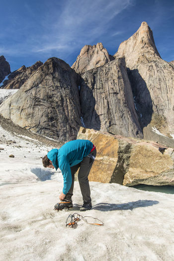 Full length of man on rocky mountains against sky